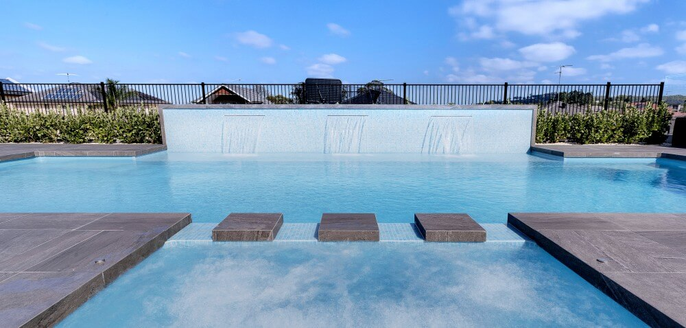 Nowra Local Pools and Spas Swimming pool with three water wall water features