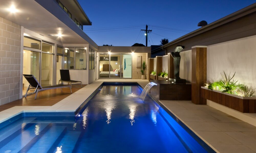 Nowra Local Pools and Spas Water wall water feature in a Fastlane fibreglass pool