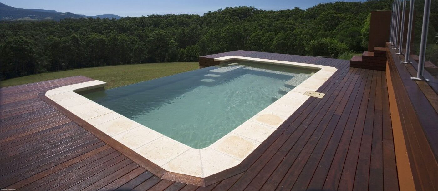 How to Know if an Infinity Pool is Right For You Timber decking around infinity pool